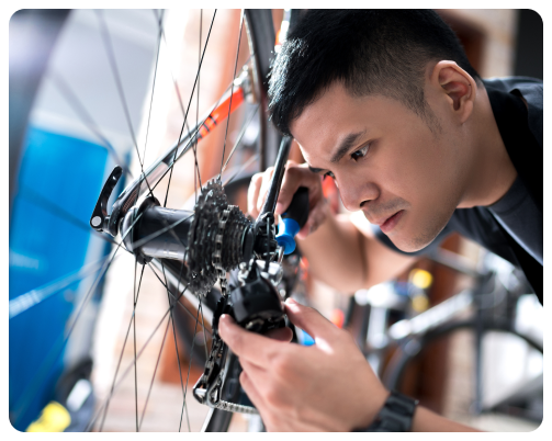 A young bicycle mechanic apprentice
