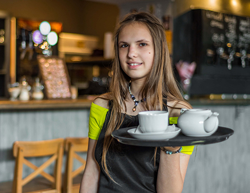 A young female working in a coffee shop