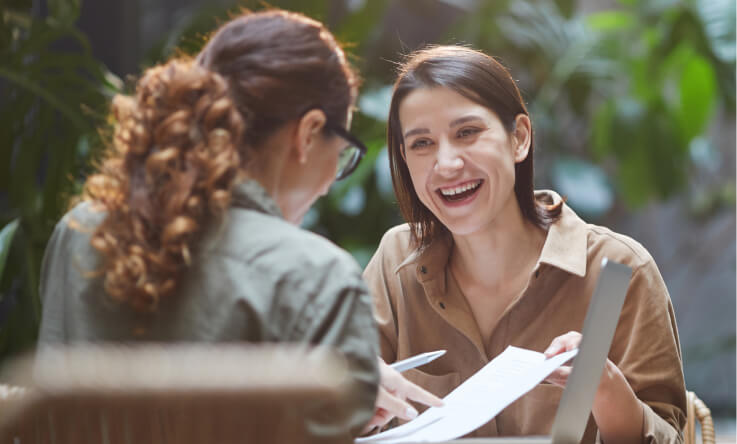 Two smiling people in a casual job interview