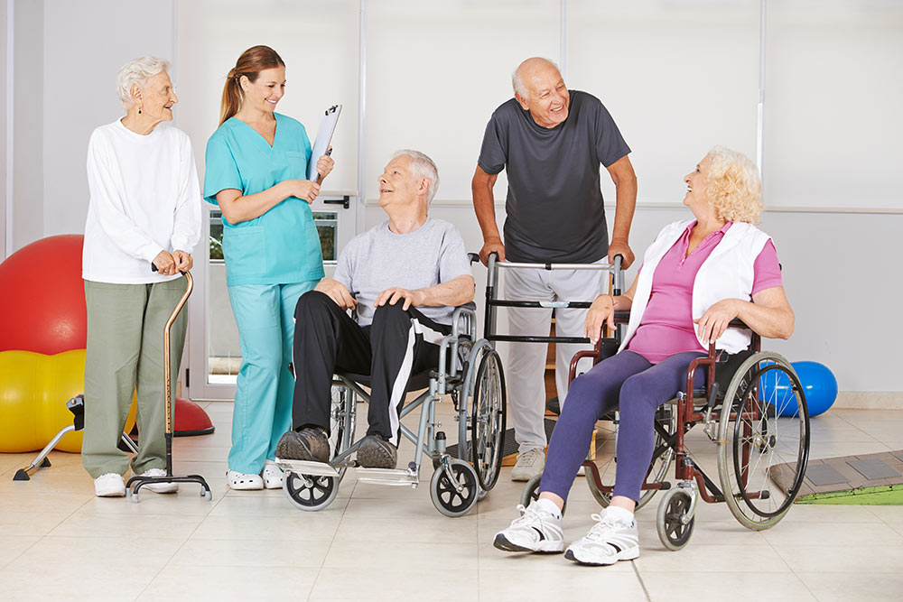 Elderly men and women with a doctor