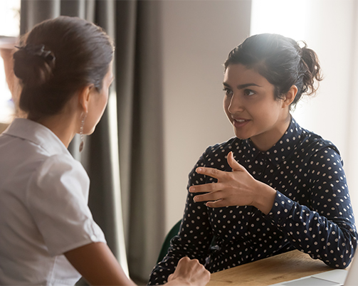 A female employment navigator speaking to a service users